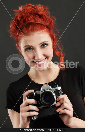Redhead holding a camera stock photo, Photo of a beautiful female with red hair holding an old film camera. by © Ron Sumners