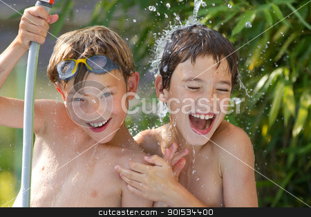 children playing in the water stock photo, Young children playing in the water by Christophe Rolland
