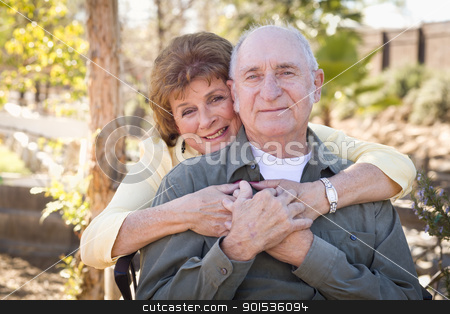 Happy Senior Couple Relaxing in The Park stock photo, Happy Senior Couple Enjoying Each Other in The Park. by Andy Dean