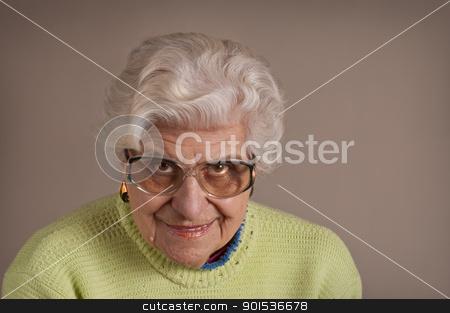 Senior lady portrait. stock photo, Senior lady portrait, smiling, glasses, with copy space.  by Pablo Caridad