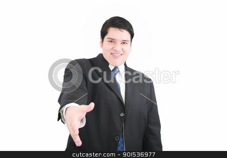 Handsome executive extending hand to shake  stock photo, Handsome executive extending hand to shake   by dacasdo
