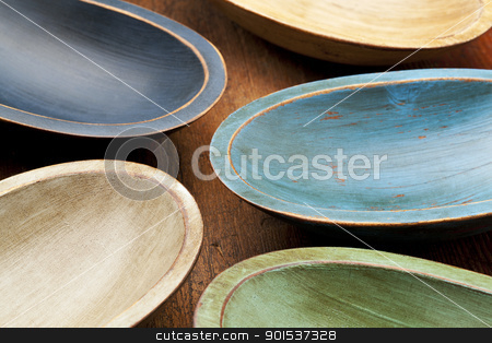 wooden rustic bowls stock photo, abstract composition  of five rustic painted dough bowls against grunge wood surface by Marek Uliasz