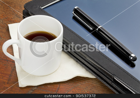 tablet computer, stylus and coffee stock photo, cup of espresso coffee, stylus pen and tablet computer in black leather case on a grunge wood by Marek Uliasz
