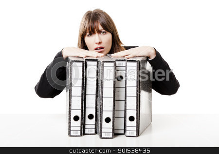 Stressed woman at the office stock photo, Exhausted woman in the office full of folders and work to do, isolated on white background by ikostudio