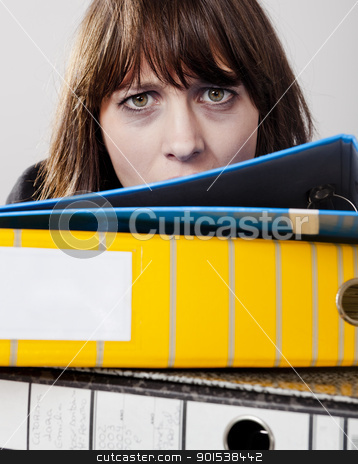 Exhausted business woman stock photo, Exhausted business woman in the office with a pile of folders at front by ikostudio