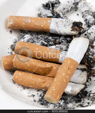 cigarette stock photo, ashtray full of cigarettes on white  by Rob Bouwman