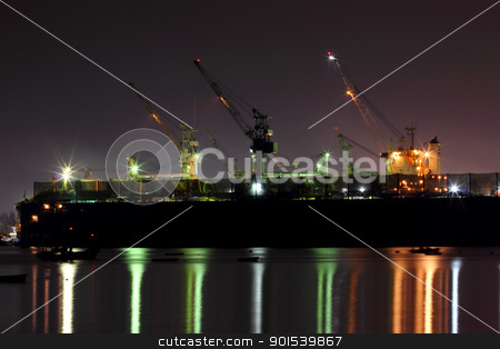 Port cargo cranes work in pier at night  stock photo, Port cargo cranes work in pier at night  by Sailom