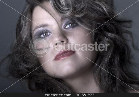 Beautiful Young Woman stock photo, Beautiful young brunette portrait on dark background by Tiramisu Studio