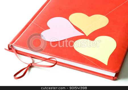 Three Hearts on a Diary stock photo, Three heart shaped sticky notes sticked to red diary isolated on white background. Valentines Day and love concept. by Tiramisu Studio