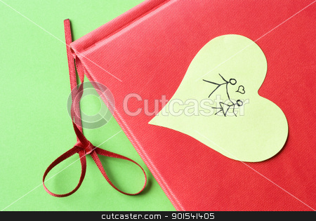 Happy Couple Holding Hands stock photo, Sketch of a happy couple holding hands on a heart shaped sticky note attached to red diary. by Tiramisu Studio