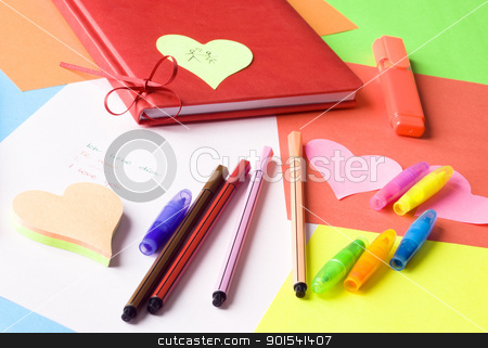 Love message in four languages stock photo, Love message in different languages arranged with pens, markers, diary and colorful stationery. by Tiramisu Studio