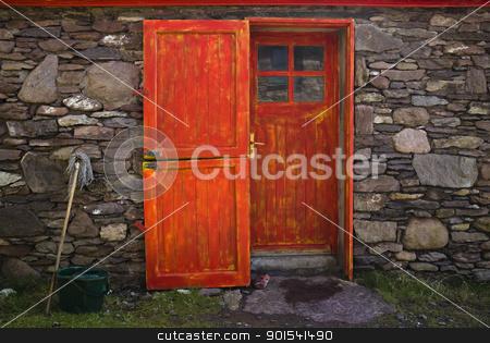 Historic Cottage Door and Window stock photo, Old historic stone cottage door and window, County Kerry, Ireland by Tiramisu Studio