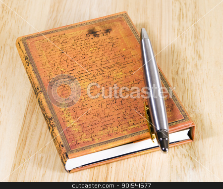 Closed notebook with pen stock photo, Hardcover notebook with silver ballpoint arranged on wooden background by Tiramisu Studio