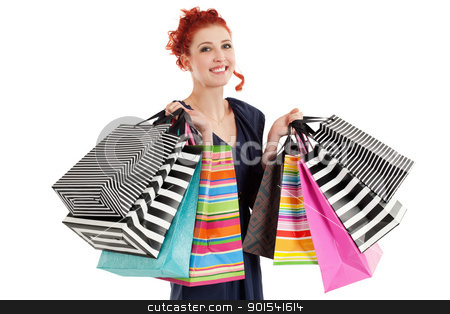Beautiful woman holding colorful bags stock photo, A very happy shopaholic girl holding many shopping bags and smiling about her rabid purchases. by © Ron Sumners