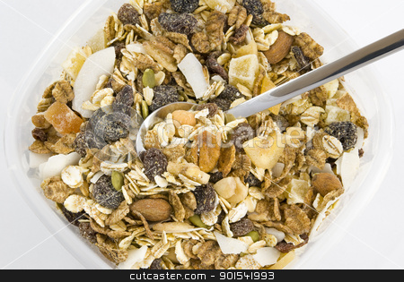 Multi fruit and nut muesli stock photo, Multi fruit and nut muesli with silver spoon arranged in plastic box and isolated on white background by Tiramisu Studio