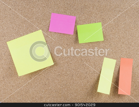 Colorful sticky notes stock photo, Colorful sticky notes attached to a corkboard by Tiramisu Studio