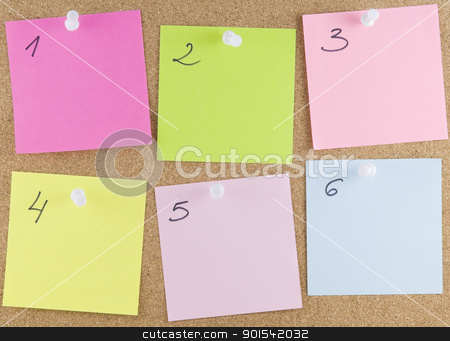 Colorful sticky notes stock photo, Colorful sticky notes attached to a corkboard with white thumbtacks by Tiramisu Studio