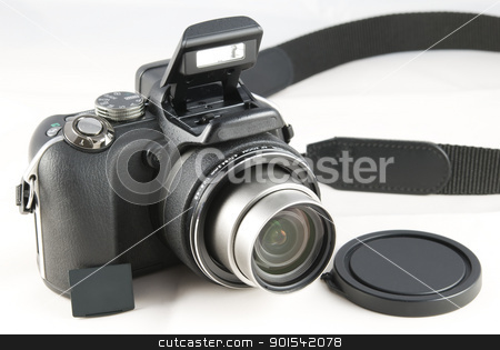 Digital camera stock photo, Point and shoot zoom digital camera on white background by Tiramisu Studio
