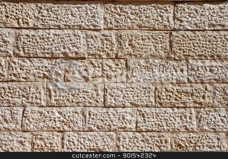 Texture of wall of beige stone blocks stock photo, Wall built of Jerusalem stone blocks (limestone) by Shlomo Polonsky
