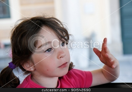 Cute serious seven years girl gestures with her hand stock photo, Cute serious seven years girl gestures with her hand by Shlomo Polonsky