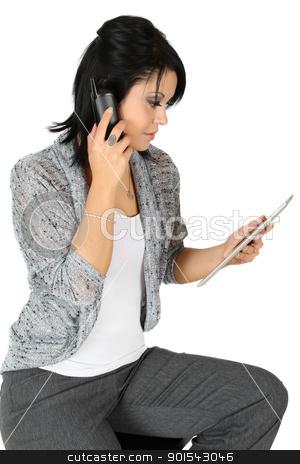 Business woman stock photo, Beautiful brunette business woman talking on phone by Vanessa Van Rensburg