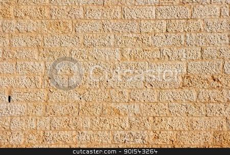 Golden wall built of yellow stone blocks  stock photo, Golden wall built of yellow stone blocks  by Shlomo Polonsky