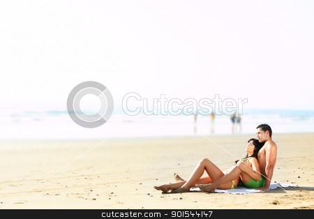 couple lying on the beach stock photo, portrait  of a sexy couple lying on the beach by pablocalvog