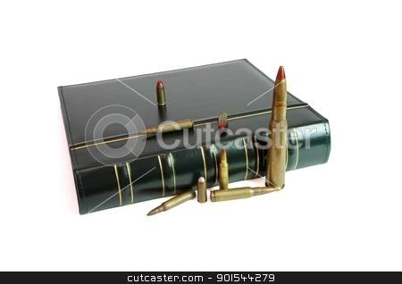 Dark book and cartridges of various calibers isolated stock photo, Dark book and cartridges of various calibers isolated by Shlomo Polonsky