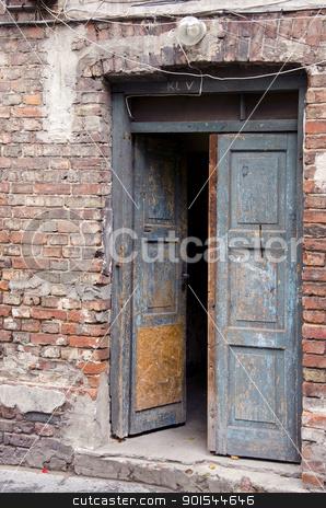 grunge masonry house doors brick wall background  stock photo, Ancient grunge masonry house wooden doors and red brick wall background.  by sauletas