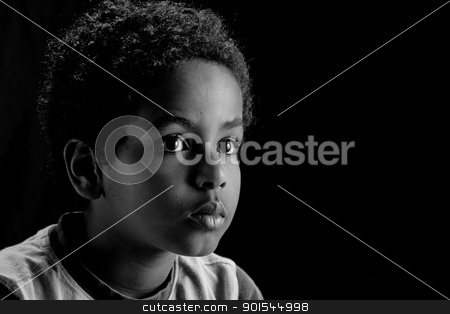 Portrait of a young boy stock photo, A low key portrait picture of a young Ethiopian boy . by derejeb