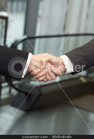 Handshake stock photo, Close-up of a handshake with selective focus by Anne-Louise Quarfoth