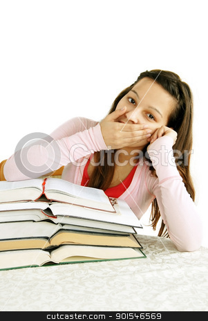Teenage girl tired of learning stock photo, tired caucasian teenage girl sitting at the desk with arm on her mouth, yawning by Julija Sapic