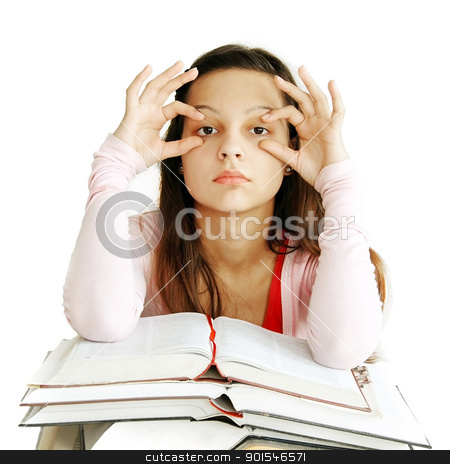 Teenage girl learning stock photo, tired caucasian teenage girl sitting at the desk with arms holding eyes opened by Julija Sapic