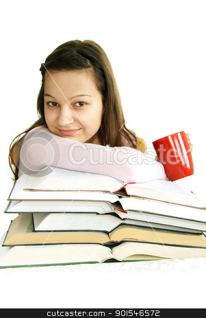 Happy teenage girl with books and tea stock photo, happy caucasian teenage girl sitting at the desk with stack of opened books and tea cup by Julija Sapic