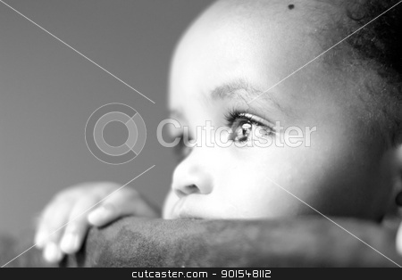 Gazing stock photo, A little baby girl staring into the light with amusement by derejeb