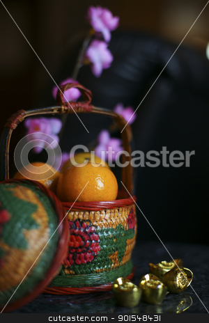 Chinese new year decoration stock photo, Basket of Oranges with Gold ingots and plum blossom by pixs4u