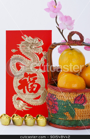 Chinese new year decoration stock photo, Basket of Oranges with Gold ingots and blessing word, focus at the word by pixs4u
