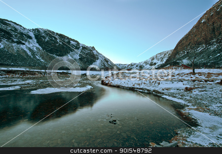 A river flows toward a Fjord in Norway stock photo, A river flows toward a Fjord in Norway, above the Arctic Circle in Winter by Ulrich Schade