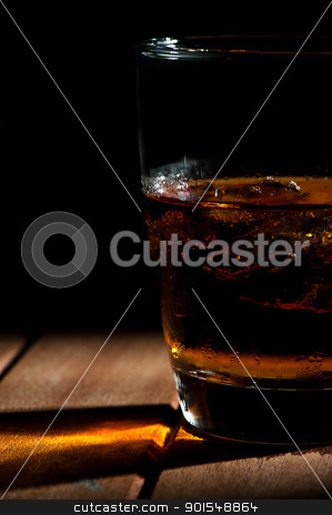 A glass of wiskey with ice stock photo, A glass of wiskey with ice by p.studio66