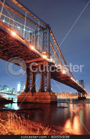 New York City Manhattan Bridge stock photo, New York City Manhattan Bridge closeup with downtown skyline over East River. by rabbit75_cut