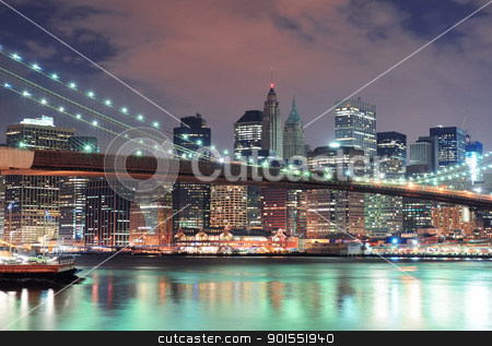 New York City stock photo, New York City Manhattan downtown skyline with skyscraper and water reflection over East River at night by rabbit75_cut