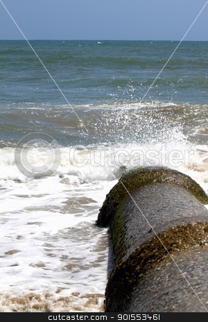 Pollution stock photo, Sewage pipe having their outlet right into the ocean pollutiong the water. by Henrik Lehnerer