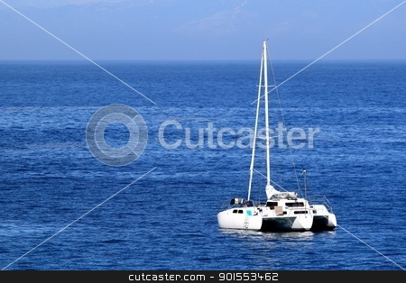 Sailboat stock photo, Sailboat anchoring in nice blue ocean water and sky. by Henrik Lehnerer