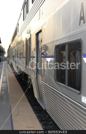 Train stock photo, Side view of a train standing in a station. by Henrik Lehnerer