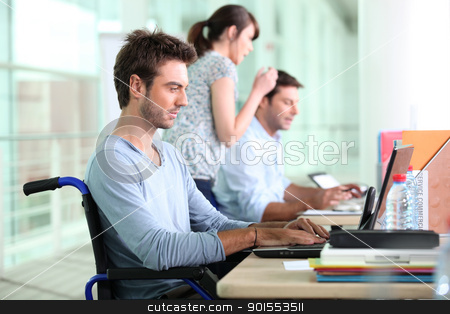Three people working in a sales department, one of them in a wheelchair. stock photo, Three people working in a sales department, one of them in a wheelchair. by photography33