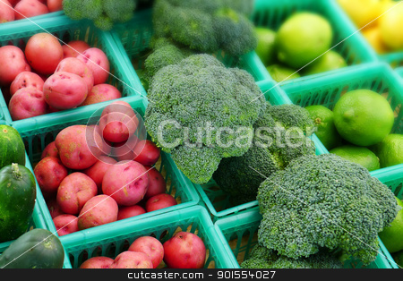 Broccoli, Limes, Red Potatoes and Cucumbers stock photo, Broccoli, Limes, Red Potatoes and Cucumbers at an outdoor market by ikehayden