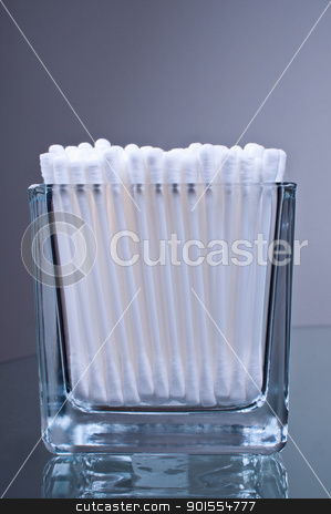 Cotton buds in glass stock photo, Cotton buds in glass on a glass table by Nanisimova