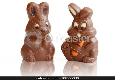 Two Chocolate Easter Bunny stock photo, Chocolate Easter Bunny reflection on white background by manaemedia