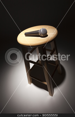 Microphone Laying on Wooden Stool Under Spotlight stock photo, Microphone Laying on Wooden Stool Under Spotlight Abstract. by Andy Dean