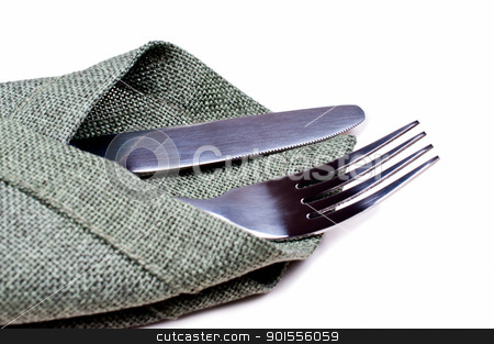 Knife and fork on green napkin close up stock photo, Knife and fork on green napkin by Nanisimova